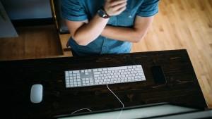 man sitting at keyboard