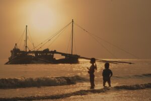 Children watching a boat.