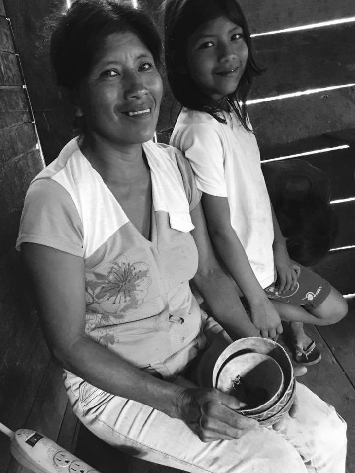 A mom and daughter in an aborigen house in the jungle. Napo, Tena.