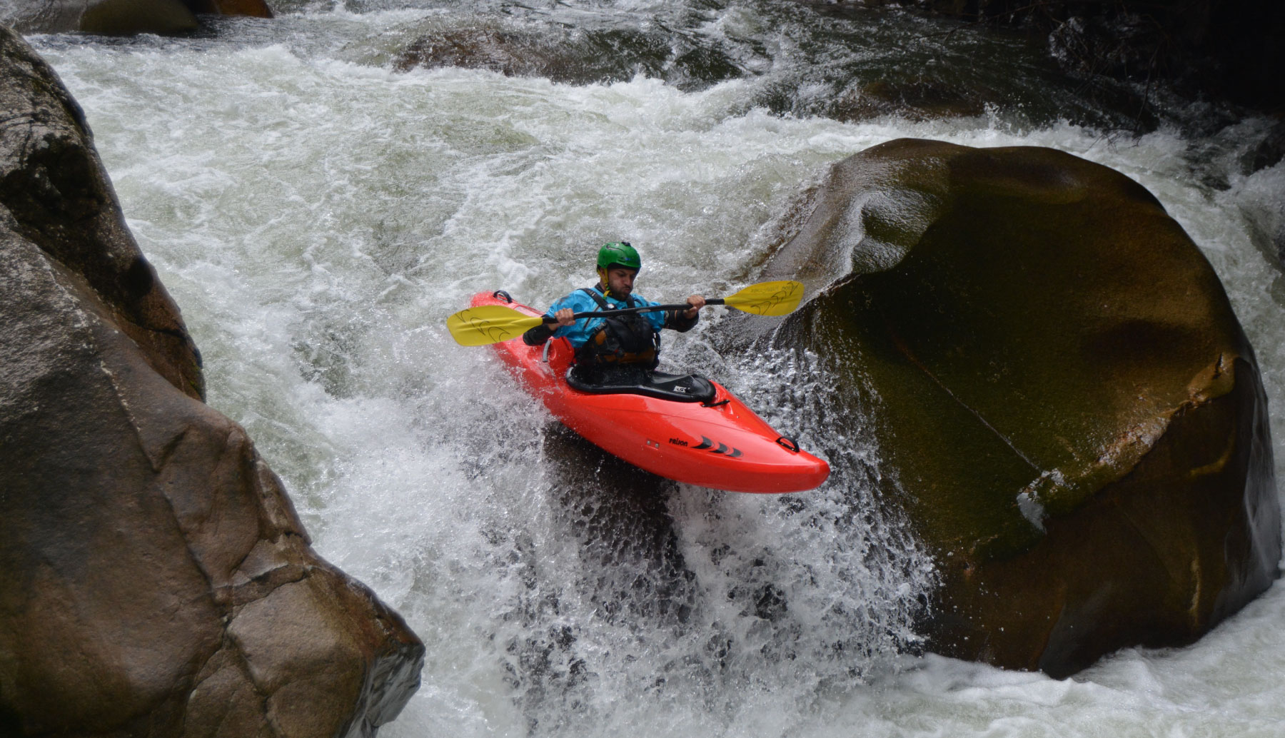 Kayaking guide descending river