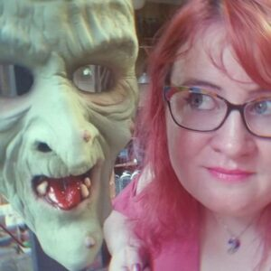 Lauren Spear with Don Post Studios Hagatha mask