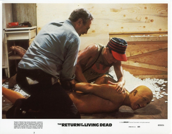 holding down the reanimated corpse in The Return of the Living Dead (1985)