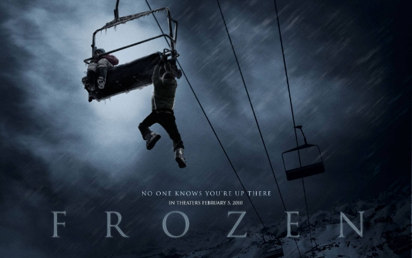 man dangling from a sky lift high in the air in Frozen