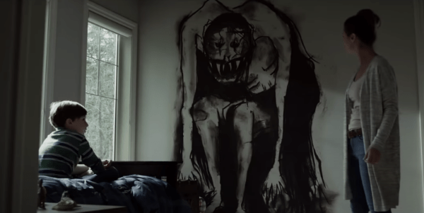 Mom and son in bedroom looking at a scary monster drawing on the wall in Z
