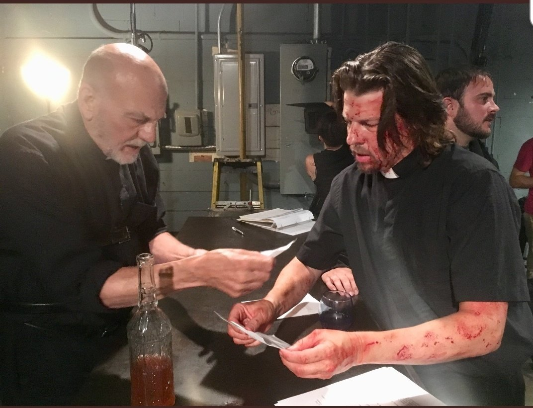 Carmen Argenziano (Father Gabe) and Kyle Hester (Father Joshua) going over Preacher Six's script, behind-the-scenes.