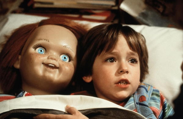 Andy and Chucky tucked into bed in Child's Play