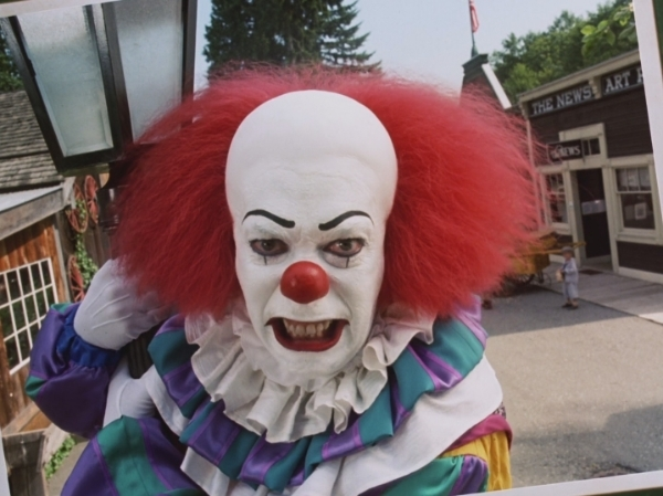 Tim Curry as Pennywise in It 1990