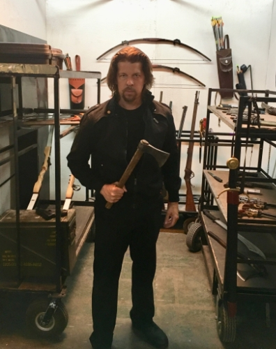 "Kyle Hester, getting ready for some horror-action in the ""weapons room,"" behind-the-scenes of Preacher Six!"
