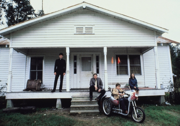 the main cast of Silver Bullet posed outside a house