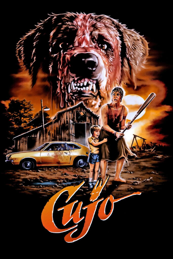 1983 Cujo movie poster with mom (Dee Wallance) and kid standing in front of a barn lookin' scared while a big St. Bernard dog's face looms in the background, fangs bared and mouth foamy
