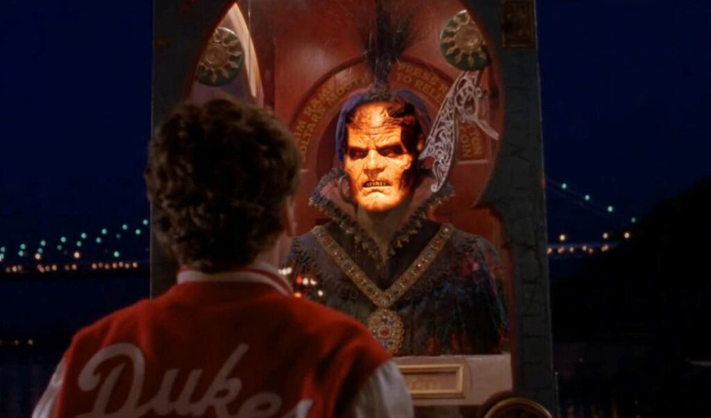 Screenshot of the Zoltar machine from Big with the face of the Djinn from Wishmaster