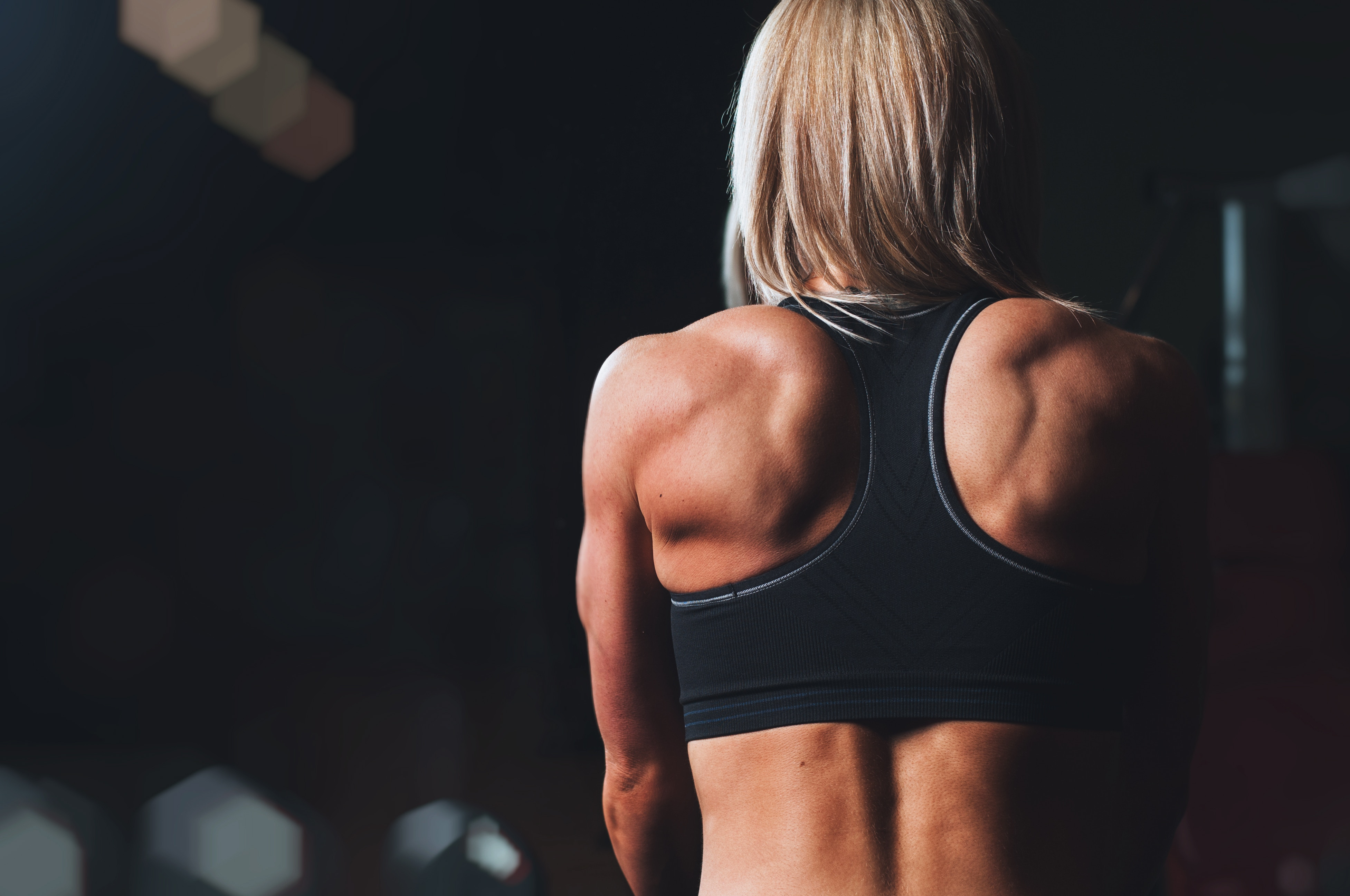 Female bodybuilder muscle workout training