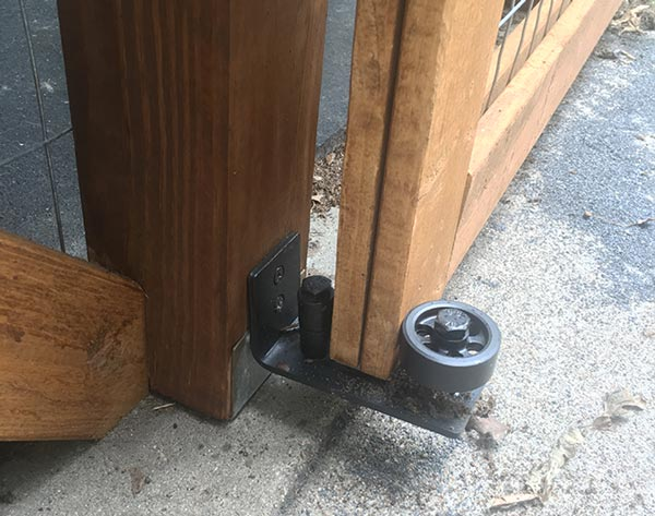 door guide keeps the barn door from swinging out and allowing houdini to escape