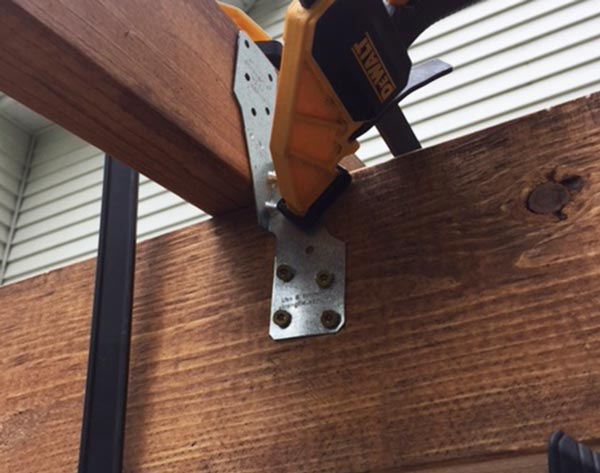 the process of securing the roof supports to the 2x6's