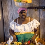 Colombian ladyA street vendor sells fruit on the streets of Cartagena in Colombia.