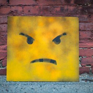 Quadro com emoji representando uma cara brava