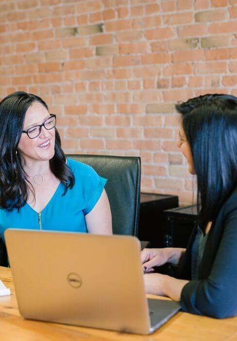 two office employees discussing
