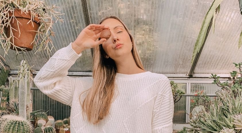 girl standing near plants