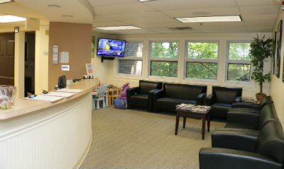 dentist reception area photo spacious and comfortable in Orange, CT