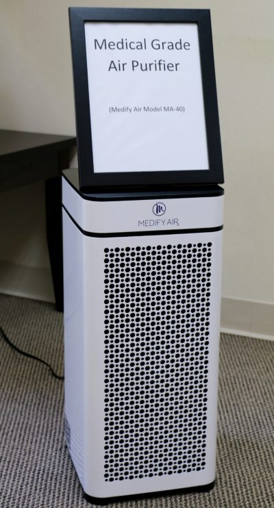 medical grade air purifier in dental reception area.