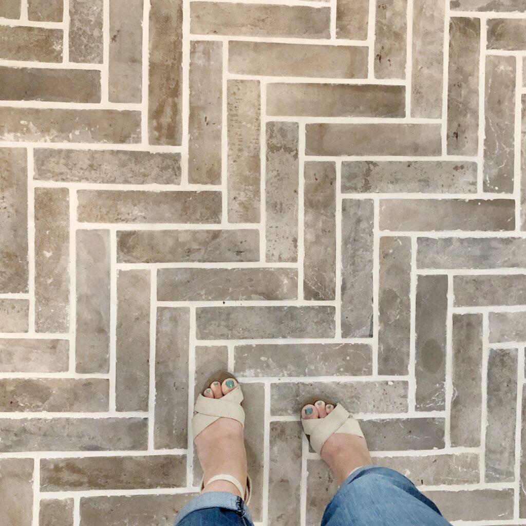 Tile flooring that looks like brick in a herringbone pattern