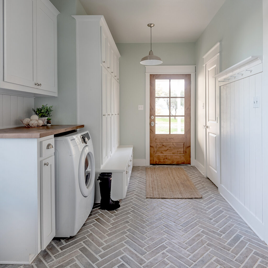 laundry room showing brick floor
