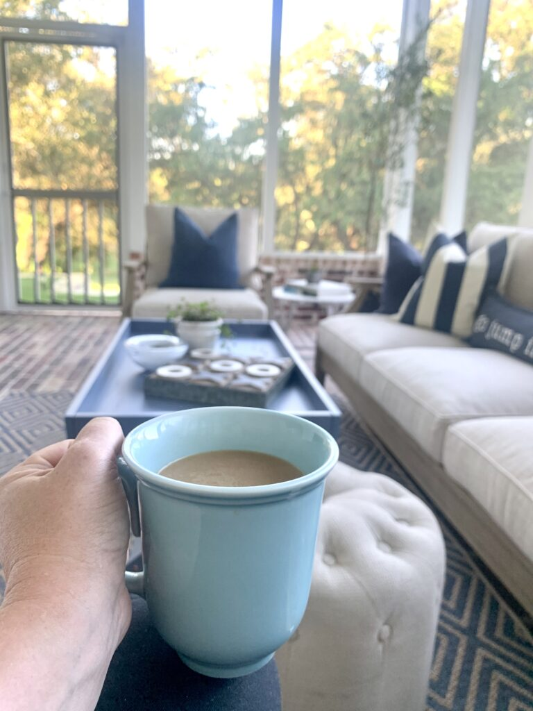 Enjoying a cup of coffee out on a screened in porch