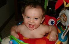 Happy Child in Baby Walker