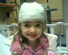 Child with bandaged head