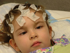 Child with medical equipment