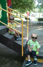 Boys in sunglasses at park