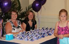 Women at volunteer table