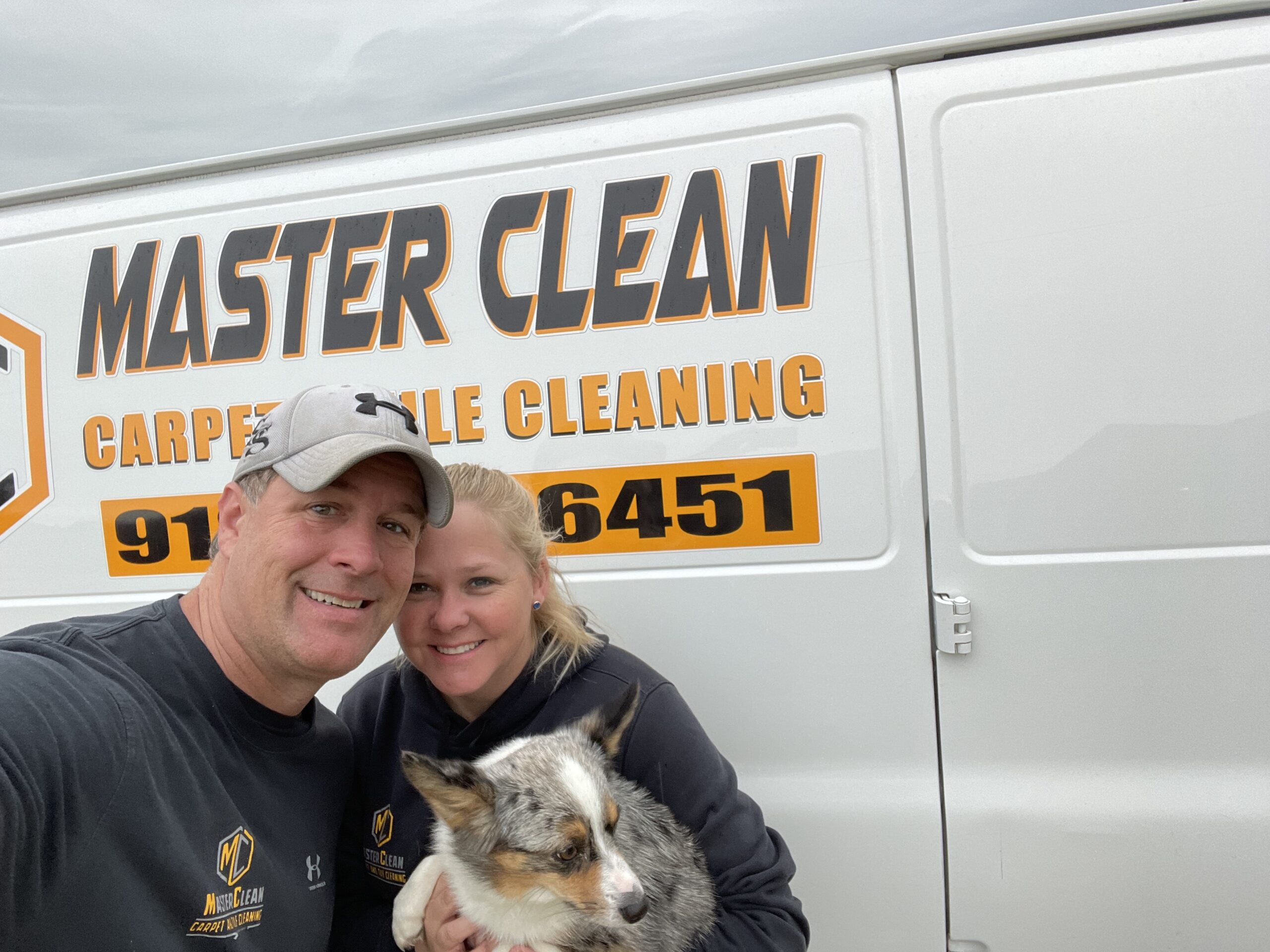 A picture of the Master Clean owners with a dog.