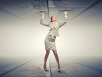 Woman in a suit propping up a ceiling