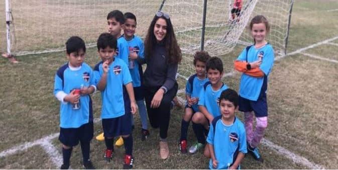 Coach Carine and her U8 soccer team.