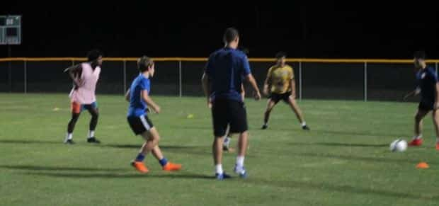 Hope Soccer Boys Team Running a Drill at Practice.