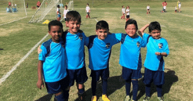 U8 players hugging after a game