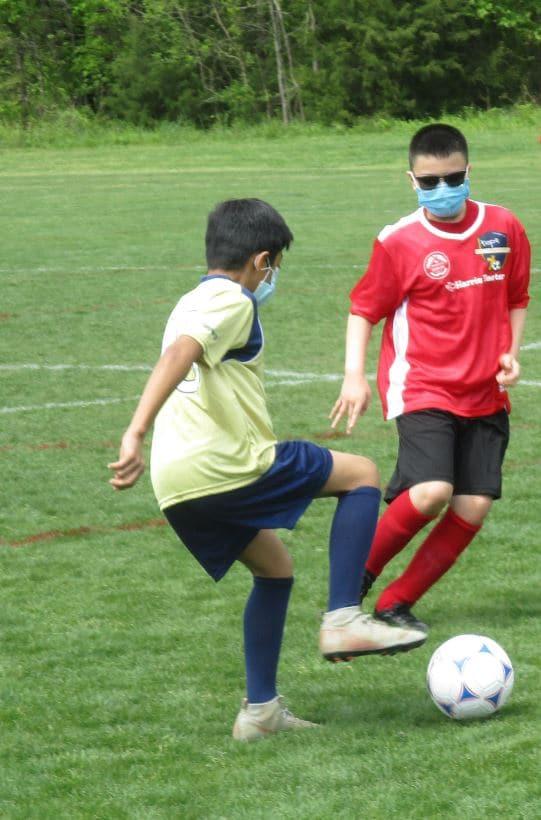 U12 soccer players playing soccer