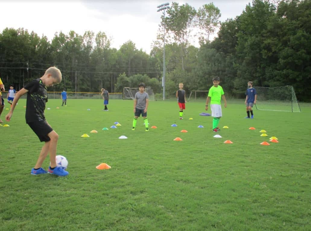 Hope Soccer players running through drills at practice.