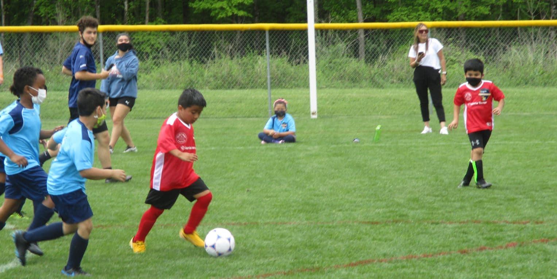 U8 player dribbling the ball