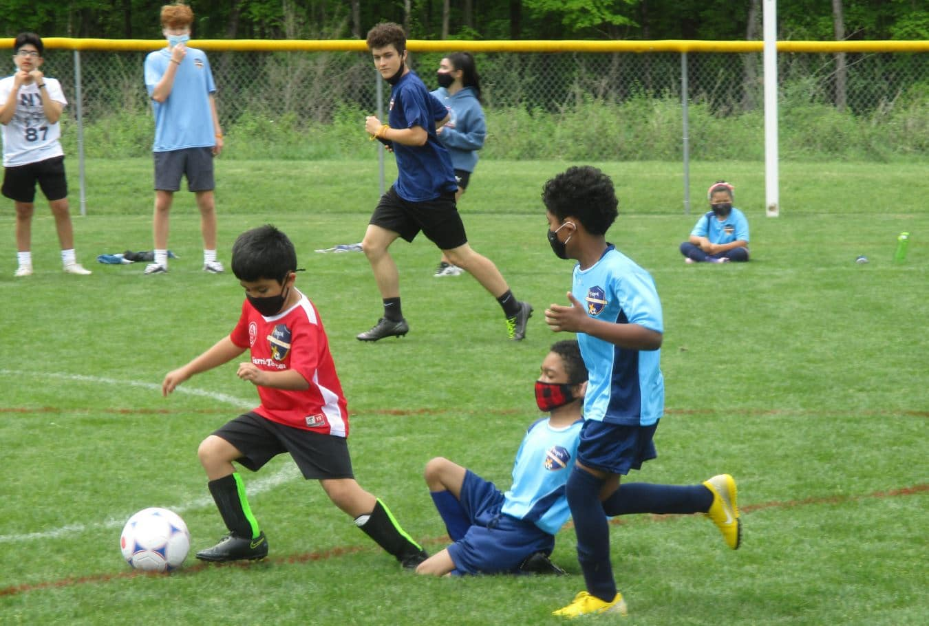 Hope Soccer U8 team playing a scrimmage.