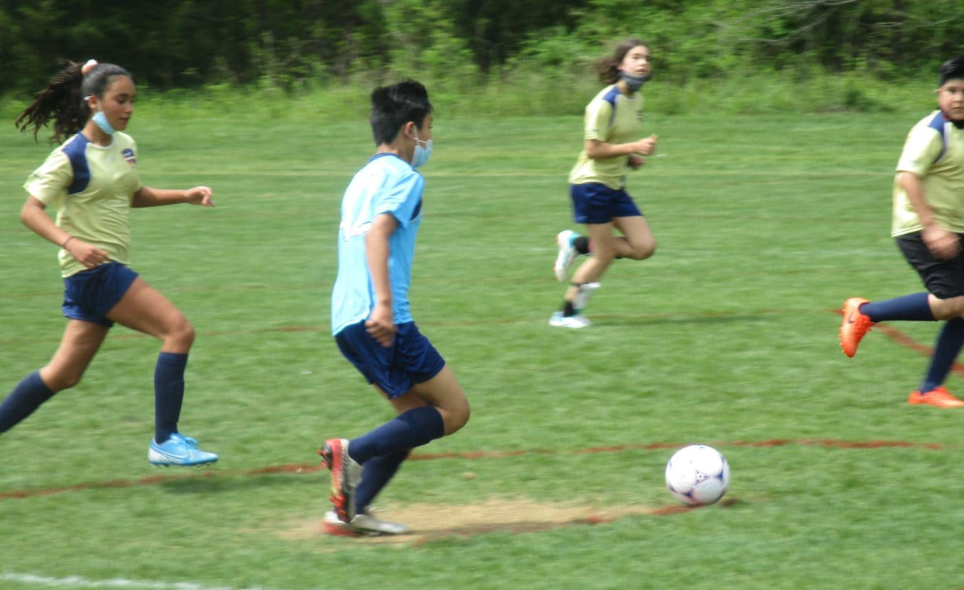 Left mid dribbling the ball down the line.