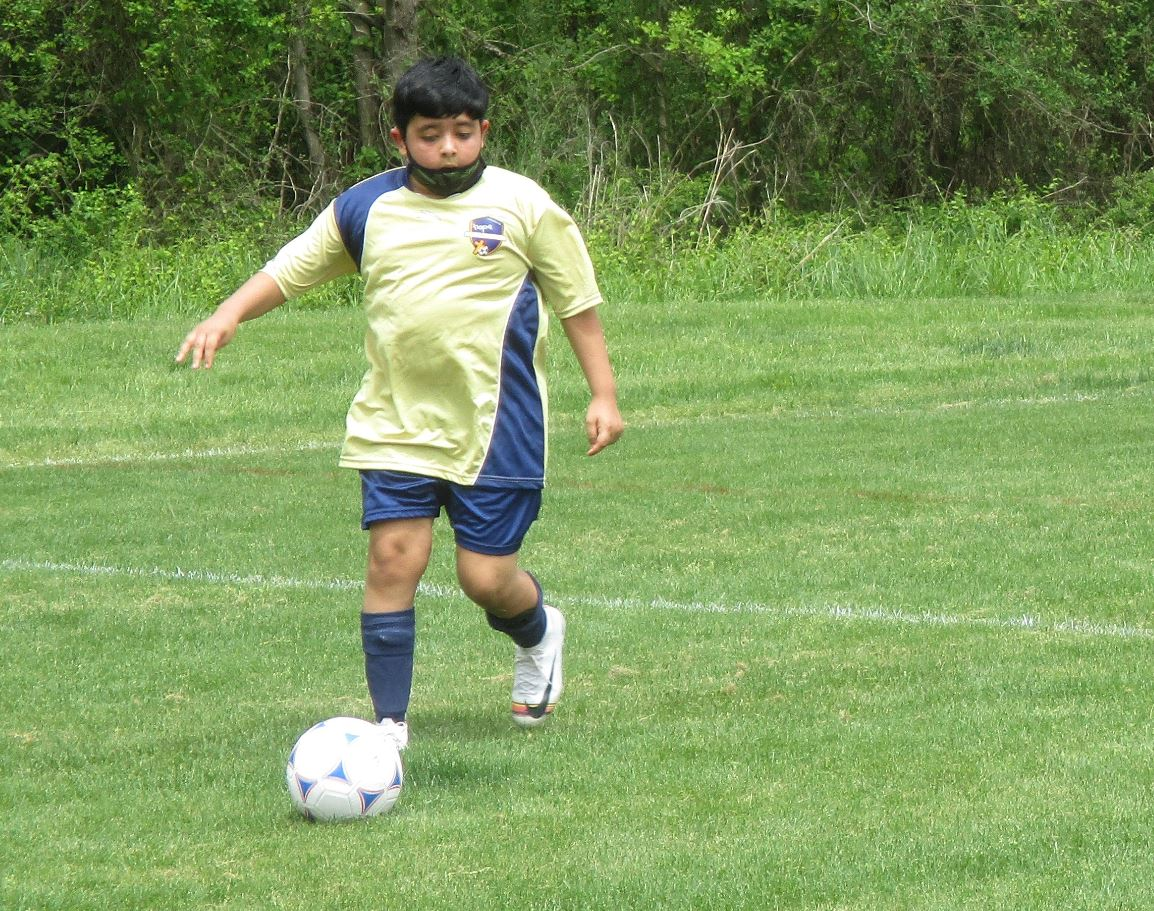 Full back dribbling the ball.
