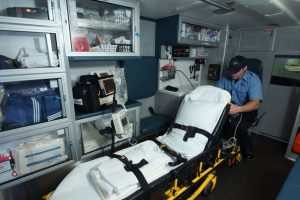 EMT sitting in ambulance