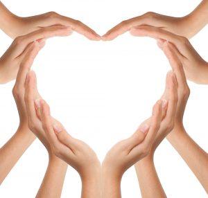 Hands put together to create a heart shape
