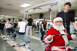 Santa Claus doing exercises at a gym