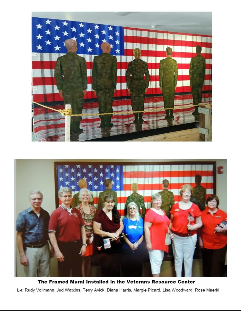 Framed Mural at the Veterans Resource Center and artists who made it all a reality for the facility.