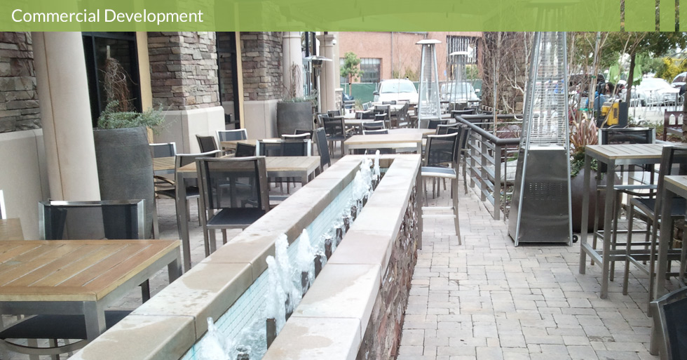 Melton Design Group, a landscape architecture firm, designed this fountain at Dave and Buster's in Roseville, CA. This trough like fountain is the centerpiece of the outside patio complete with brick and cobblestone textured walls and flooring.