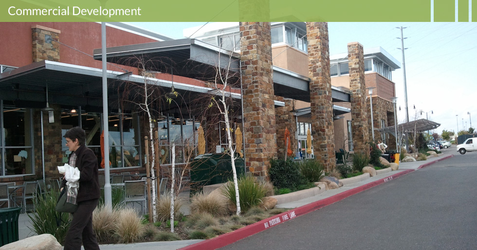 Melton Design Group, a landscape architecture firm, designed the trellis at Whole Foods in Roseville, CA. A modern look, with dark grey and steel protection from weather complete with warm, cobblestone pillars.