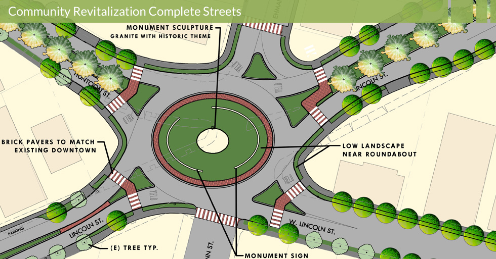 Melton Design Group, a landscape architecture and Five-way Roundabout at Lincoln Huntoon in Oroville, CA. Including a granite monument sculpture with a historic theme, brick pavers to match existing downtown, and low landscaping near the roundabout.